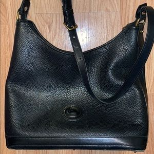 Dooney & Bourke used but in good condition bag .